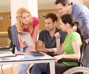 iStock_000019436020_Medium-handicappedpersoninwheelchairatworkrtxt2415